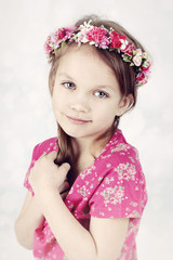 Beautiful little girl with floral wreath