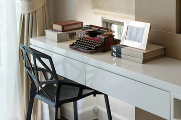 decorative working table with typewriter and books