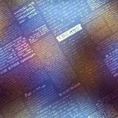 Newspaper pattern on blurred background.