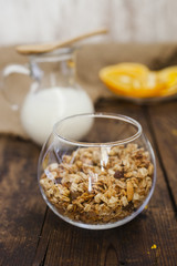 muesli with a bowl and milk in a jug