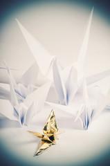 flock of origami cranes
