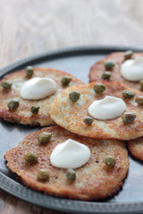 Potato pancakes with sour creme and capers.
