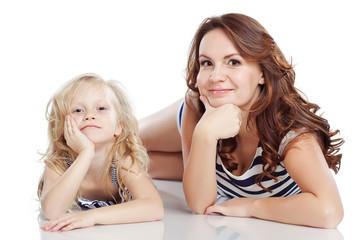 Happy mother and daughter in studio