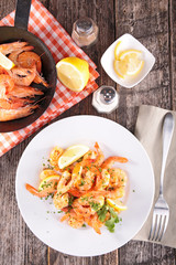 fried shrimp with parsley and ingredient on table