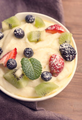 Bowl of semolina dessert with berries