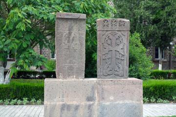 Two grey carved khachkar stones, in Echmiadzin