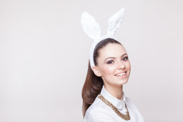 portrait of beautiful smiling model in bunny costume