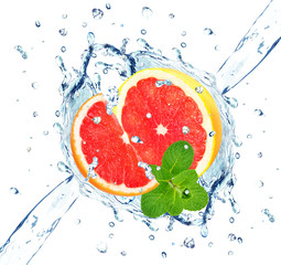 splash of grapefruit and mint isolated on white