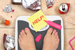 Feet on bathroom scale with word Help and junk food garbage - 80718564