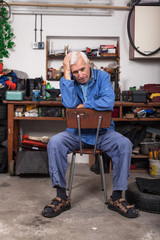 Frustrated senior worker in the workshop