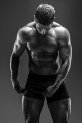 Man with great body posing in studio