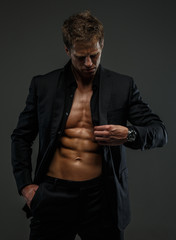 Muscular man in a suit