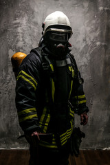 Firefighter in uniform on grey background
