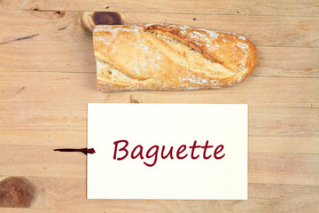 food background - baguette bread on wood table