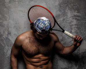 Man with naked torso and tennis racket