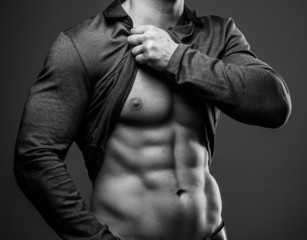 Fashionable guy with muscular body posing