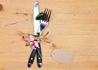 knife and fork on wood background - copy space