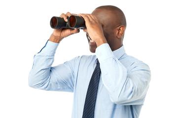 African male using binocular