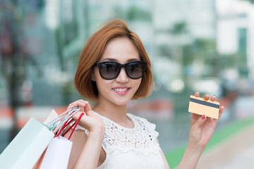 Female shopaholic with credit card