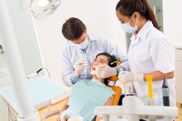 Examining female patient
