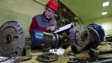 Maintenance Engineer Checking Technical Data