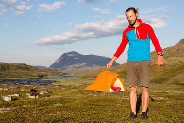 Hiker and little tent