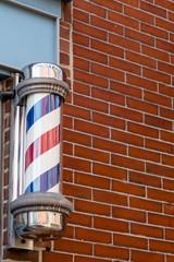 Barber Pole and Brick Wall