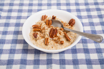 Oatmeal with Pecans and Cinnamon and Spoon