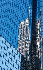 Old Building Reflected in Modern Blue Glass Tower