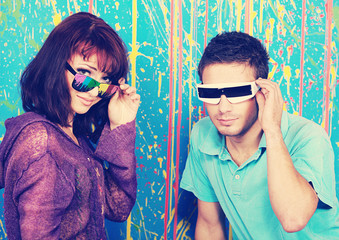 Happy young couple in funky sunglasses
