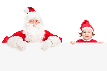 Santa and a girl standing behind signboard