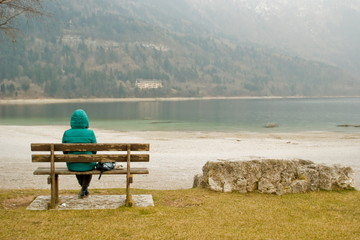 Woman sitting in solitude