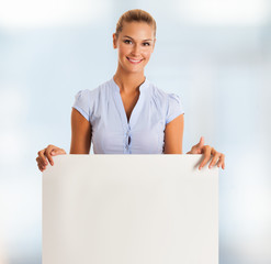 Woman showing a blank panel