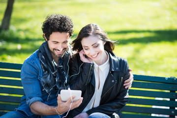 Couple enjoying music together