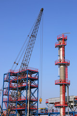 new refinery construction site with crane