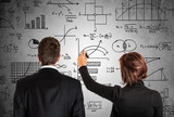 Business people writing math formulas