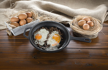 Kavurma with egg on iron cast pan with space for your text