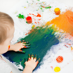 children's hands in paint