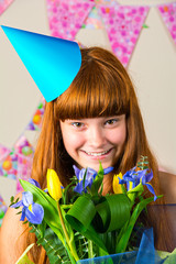 Funny girl in birthday cap