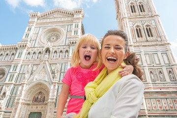 Portrait of happy mother and baby girl in florence