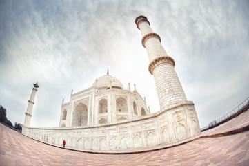 Woman in red near Taj Mahal