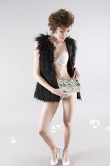 sexy european woman with fur holding us dollar money banknote