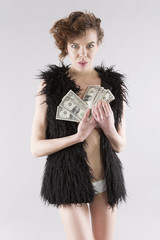sexy european woman with fur throwing us dollar money banknote