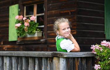 Portrait of little girl wearing a traditional Bavarian dress