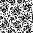 Seamless pattern with black flowers on a white background.