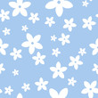 Vector seamless pattern with white flowers on a blue background.