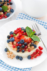 mini cheesecake with fresh berries on a plate, top view
