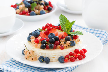 mini cheesecake with fresh berries on a plate
