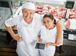 Happy Butchers With Digital Tablet In Butchery - 80733151