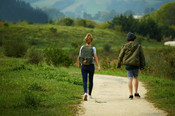 Couple hiking on a mountain trail, backpackers in nature